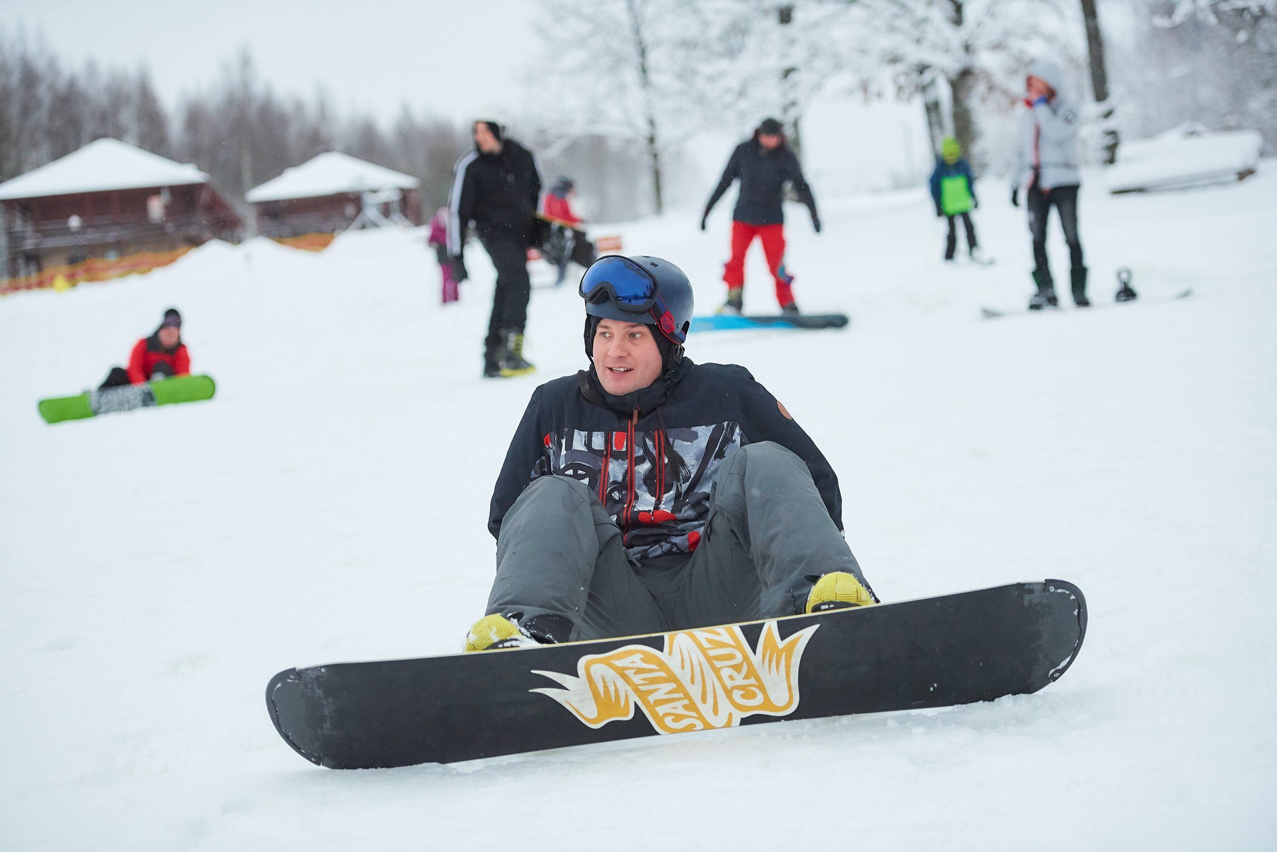 Developer is snowboarding at team-building