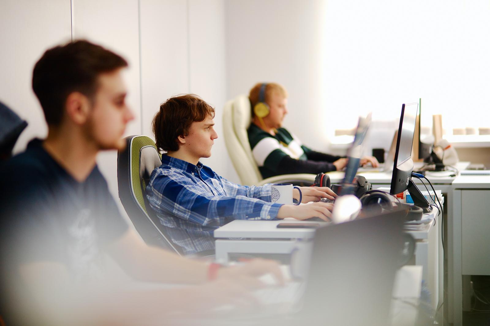 Guys develop custom software at Smart It